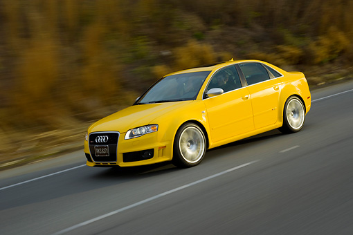 AUT 29 RK1204 01 © Kimball Stock 2007 Audi RS4 Yellow 3/4 Side View On Road In Motion