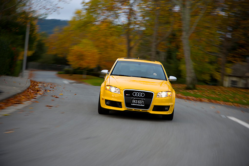 AUT 29 RK1210 01 © Kimball Stock 2007 Audi RS4 Yellow Head On View On Road In Motion