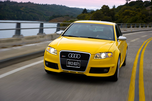 AUT 29 RK1227 01 © Kimball Stock 2007 Audi RS4 Yellow 3/4 Front View On Road In Motion