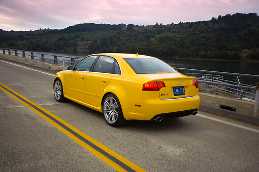 AUT 29 RK1234 01 © Kimball Stock 2007 Audi RS4 Yellow 3/4 Rear View On Road In Motion