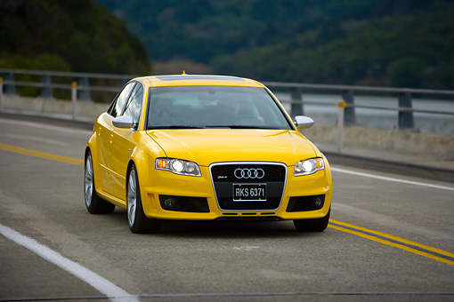 AUT 29 RK1240 01 © Kimball Stock 2007 Audi RS4 Yellow 3/4 Front View On Road In Motion
