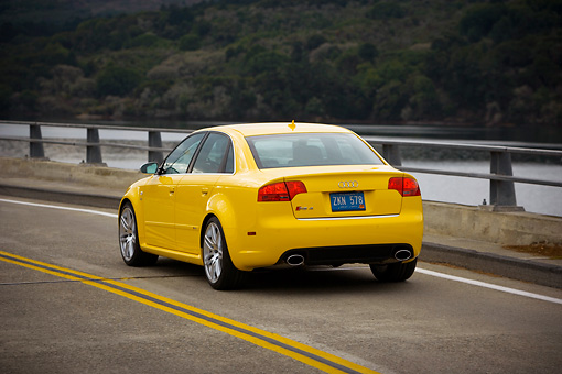 AUT 29 RK1241 01 © Kimball Stock 2007 Audi RS4 Yellow 3/4 Rear View On Road In Motion