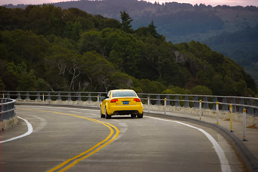 AUT 29 RK1243 01 © Kimball Stock 2007 Audi RS4 Yellow Rear View On Road In Motion