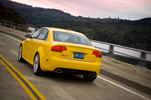 AUT 29 RK1244 01 © Kimball Stock 2007 Audi RS4 Yellow 3/4 Rear View On Road In Motion