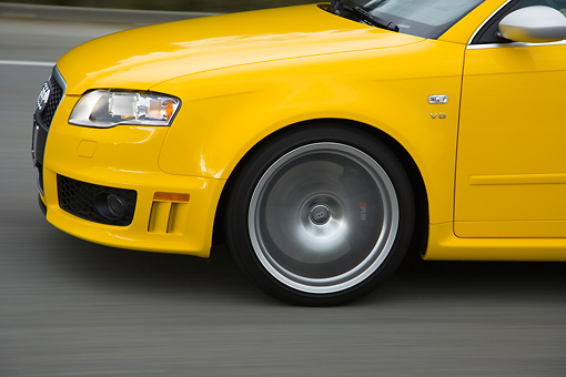 AUT 29 RK1246 01 © Kimball Stock 2007 Audi RS4 Yellow Profile View On Road In Motion