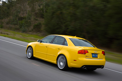 AUT 29 RK1248 01 © Kimball Stock 2007 Audi RS4 Yellow 3/4 Rear View On Road In Motion