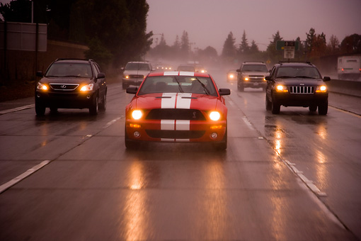 AUT 29 RK1250 01 © Kimball Stock 2007 Ford Shelby Mustang GT500 Coupe Red And White Head On View On Road In Motion