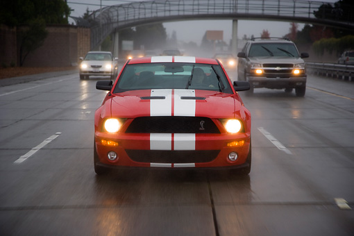 AUT 29 RK1251 01 © Kimball Stock 2007 Ford Shelby Mustang GT500 Coupe Red And White Head On View On Road In Motion