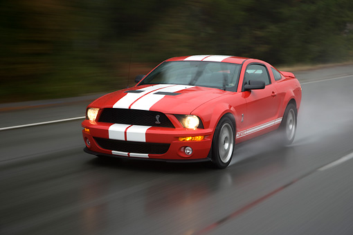AUT 29 RK1254 01 © Kimball Stock 2007 Ford Shelby Mustang GT500 Coupe Red And White 3/4 Front View On Road In Motion