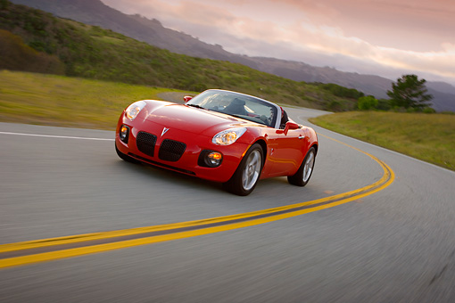 AUT 29 RK1281 01 © Kimball Stock 2007 Pontiac Solstice GXP Convertible Red 3/4 Front View On Road In Motion
