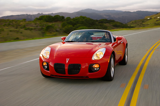 AUT 29 RK1286 01 © Kimball Stock 2007 Pontiac Solstice GXP Convertible Red 3/4 Front View On Road In Motion