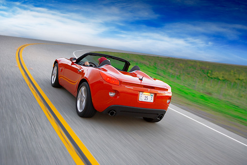 AUT 29 RK1289 01 © Kimball Stock 2007 Pontiac Solstice GXP Convertible Red 3/4 Rear View On Road In Motion