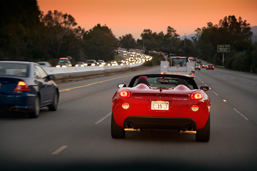 AUT 29 RK1296 01 © Kimball Stock 2007 Pontiac Solstice GXP Convertible Red Rear View On Road In Motion