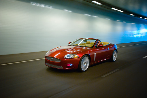 AUT 29 RK1303 01 © Kimball Stock 2007 Jaguar XKR Convertible Red 3/4 Side View On Road In Motion