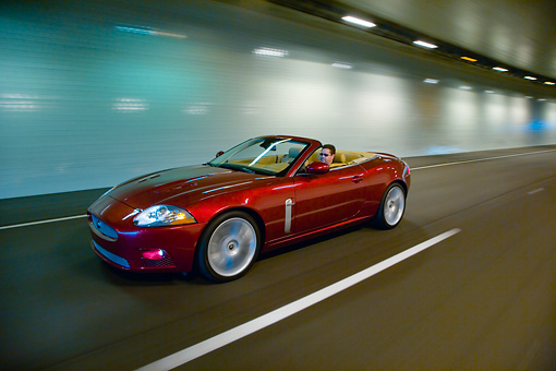 AUT 29 RK1309 01 © Kimball Stock 2007 Jaguar XKR Convertible Red 3/4 Side View On Road In Motion