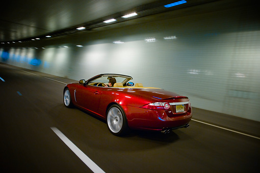 AUT 29 RK1311 01 © Kimball Stock 2007 Jaguar XKR Convertible Red 3/4 Rear View On Road In Motion