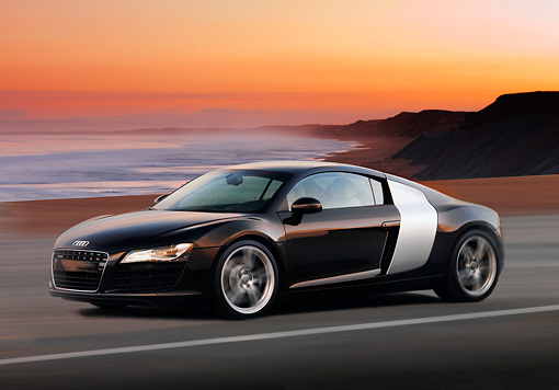 AUT 29 RK1362 01 © Kimball Stock 2008 Audi R8 Black 3/4 Side View On Road In Motion By Beach