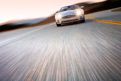 AUT 29 RK1379 01 © Kimball Stock 2008 Jaguar XKR Convertible Silver Head On View On Road In Motion