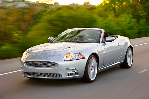 AUT 29 RK1413 01 © Kimball Stock 2008 Jaguar XKR Convertible Silver 3/4 Front View On Road In Motion