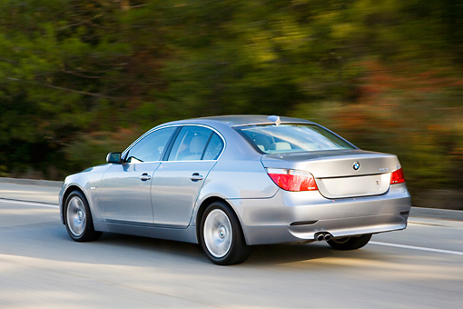 AUT 29 RK1430 01 © Kimball Stock 2005 BMW 525i Gray 3/4 Rear View Driving On Highway