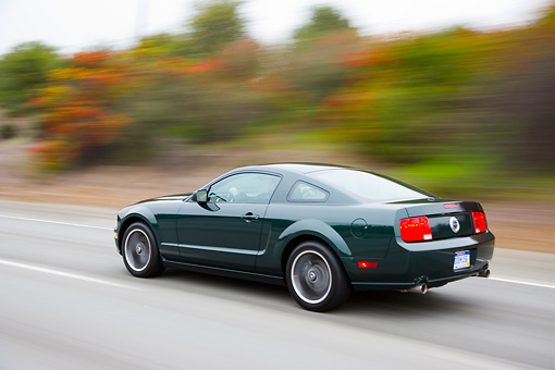 AUT 29 RK1441 01 © Kimball Stock 2008 Ford Mustang Bullitt Green 3/4 Rear View Driving On Highway