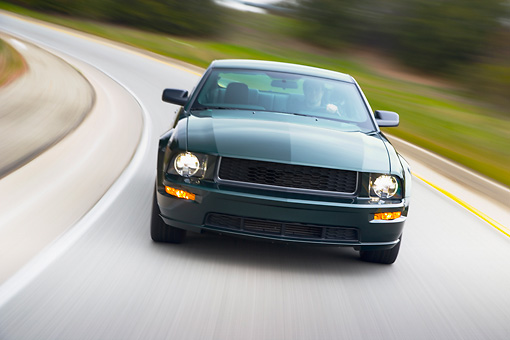 AUT 29 RK1446 01 © Kimball Stock 2008 Ford Mustang Bullitt Green Head On View Driving On Highway