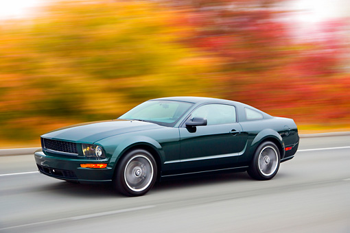 AUT 29 RK1448 01 © Kimball Stock 2008 Ford Mustang Bullitt Green 3/4 Front View Driving On Highway