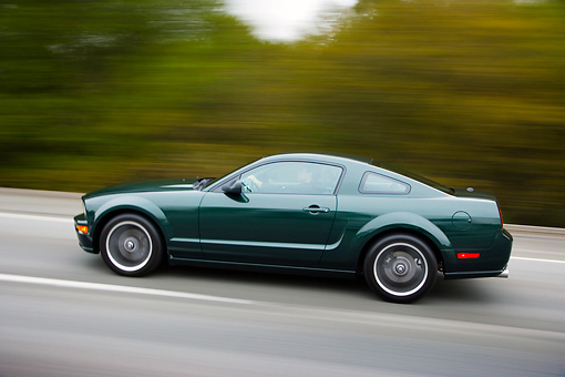 AUT 29 RK1450 01 © Kimball Stock 2008 Ford Mustang Bullitt Green Profile View Driving On Highway