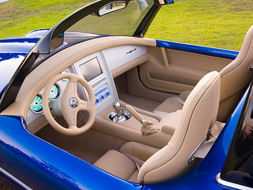 AUT 30 BK0022 01 © Kimball Stock 2010 Iconic AC Roadster Blue Interior Detail On Grass