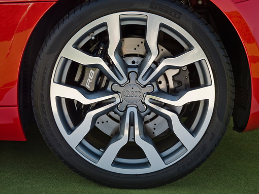 AUT 30 BK0051 01 © Kimball Stock 2010 Audi R8 5.2 FSI Quattro Red Front Wheel Detail On Grass