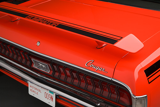 AUT 30 BK0086 01 © Kimball Stock 1970 Mercury Cougar Eliminator 428 Cobra Jet Orange Rear Bumper Detail In Studio