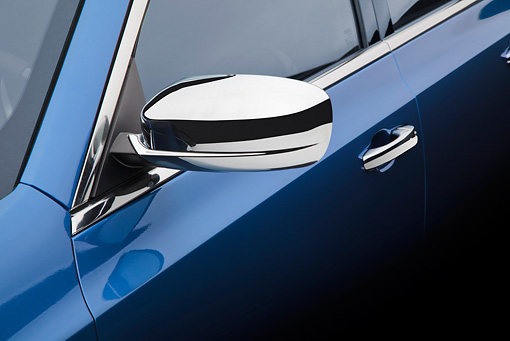 AUT 30 BK0117 01 © Kimball Stock 2012 Chrysler 300C Blue Side Mirror Detail In Studio