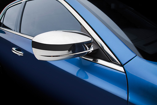AUT 30 BK0119 01 © Kimball Stock 2012 Chrysler 300C Blue Side Mirror Detail In Studio