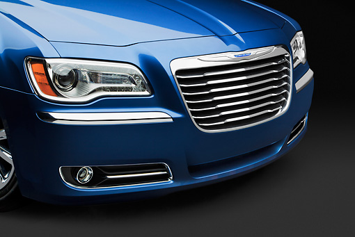 AUT 30 BK0121 01 © Kimball Stock 2012 Chrysler 300C Blue Grille Detail In Studio