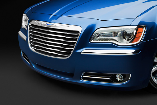 AUT 30 BK0122 01 © Kimball Stock 2012 Chrysler 300C Blue Grille Detail In Studio