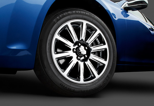 AUT 30 BK0123 01 © Kimball Stock 2012 Chrysler 300C Blue Front Wheel Detail In Studio