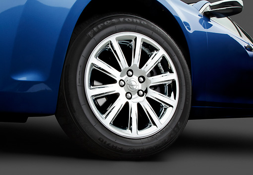 AUT 30 BK0125 01 © Kimball Stock 2012 Chrysler 300C Blue Front Wheel Detail In Studio