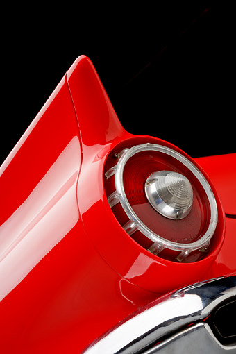 AUT 30 BK0187 01 © Kimball Stock 1957 Ford Thunderbird Red With White Top Tail Light Detail In Studio