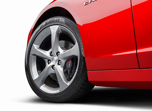AUT 30 BK0238 01 © Kimball Stock 2014 Chevrolet Camaro SS Red Front Wheel Detail On White Seamless