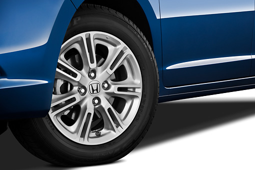 AUT 30 IZ1220 01 © Kimball Stock 2011 Honda Insight EX-L Blue Front Wheel Detail On White Seamless
