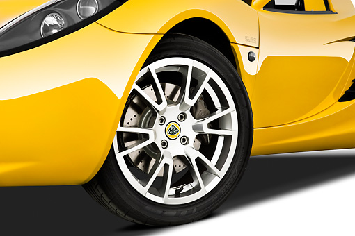 AUT 30 IZ1233 01 © Kimball Stock 2010 Lotus Elise SC Yellow Front Wheel Detail On White Seamless