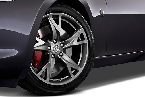 AUT 30 IZ1247 01 © Kimball Stock 2012 Nissan 370Z 40th Anniversary Edition Coupe Graphite Front Wheel Detail On White Seamless