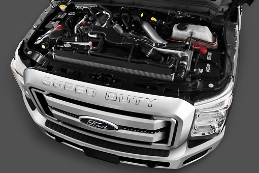 AUT 30 IZ1258 01 © Kimball Stock 2013 Ford F-250 SD Crew Cab 4X4 Pickup Truck Silver Engine Detail In Studio