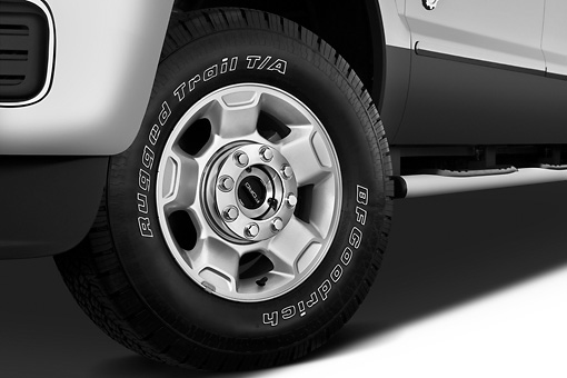 AUT 30 IZ1259 01 © Kimball Stock 2013 Ford F-250 SD Crew Cab 4X4 Pickup Truck Silver Front Wheel Detail In Studio