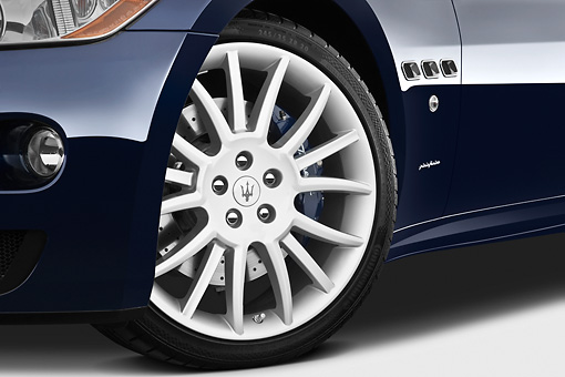 AUT 30 IZ1265 01 © Kimball Stock 2013 Maserati GranTurismo S Automatic Coupe Blue Front Wheel Detail In Studio