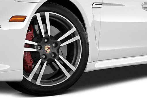 AUT 30 IZ1272 01 © Kimball Stock 2013 Porsche Panamera Turbo White Front Wheel Detail In Studio