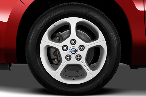 AUT 30 IZ1392 01 © Kimball Stock 2012 Nissan Leaf SL Red Front Wheel Detail In Studio