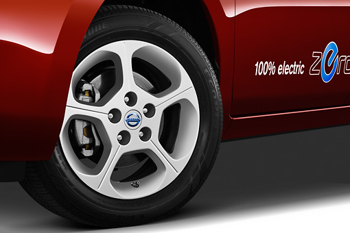 AUT 30 IZ1393 01 © Kimball Stock 2012 Nissan Leaf SL Red Front Wheel Detail In Studio