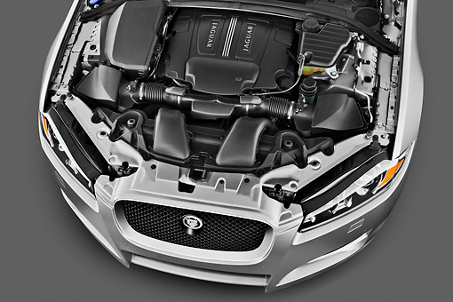 AUT 30 IZ1668 01 © Kimball Stock 2012 Jaguar XF Portfolio Silver Engine Detail In Studio