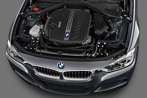 AUT 30 IZ1732 01 © Kimball Stock 2013 BMW 330d Touring Wagon Gray Engine Detail In Studio